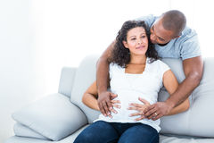 Man and woman touching pregnant belly Stock Images