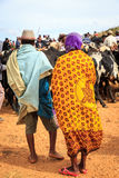 Man and woman in traditional clothes at a cow market in Africa. N Madagascar Stock Photos
