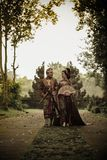 Man and Woman in Traditional Clothing Near Angkor Wat Stock Image