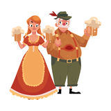 Man and woman in traditional German, Bavarian Oktoberfest costume Stock Photos