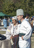 A man and woman in traditional Moldovan costumes Stock Photo