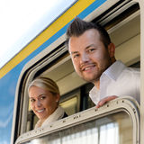 Man and woman in train looking window Stock Photography
