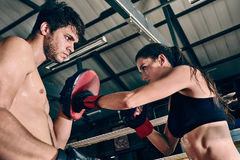 Man woman training gym boxing mma ring pads mixed martial arts f Stock Images