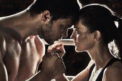 Man woman training gym boxing mma ring pads mixed martial arts f Stock Photos