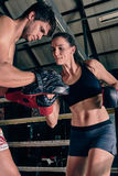 Man woman training gym boxing mma ring pads mixed martial arts f Royalty Free Stock Photos