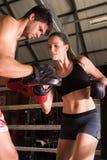 Man woman training gym boxing mma ring pads mixed martial arts f Stock Image