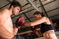 Man woman training gym boxing mma ring pads mixed martial arts f Stock Photo