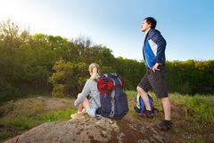 Man and woman traveler outdoors.Couple of Hikers with backpacks. Man and women traveler outdoors.Couple of Hikers with backpacks think which way to go. Travel Royalty Free Stock Images