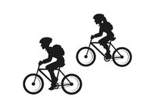 Man and woman travelers with backpacks riding mountain bikes Royalty Free Stock Image