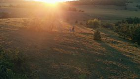 Couple hiking on sunset stock video