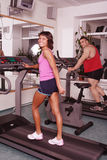 Man woman on treadmill Royalty Free Stock Image