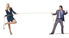 The man and woman in tug of war concept Royalty Free Stock Images
