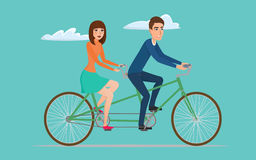 Man and woman on twin bike. Young couple riding a tandem bicycle Royalty Free Stock Image