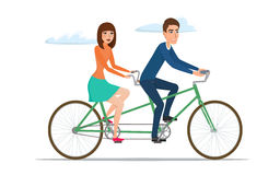 Man and woman on twin bike. Young couple riding a tandem bicycle Royalty Free Stock Photos