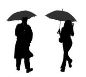 Man and woman with umbrella Royalty Free Stock Image