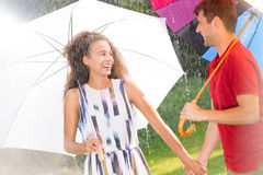 Man and woman with umbrella Stock Images