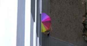 Man and woman under colorful umbrella stock video footage