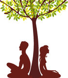 Man and woman under tree Stock Photo