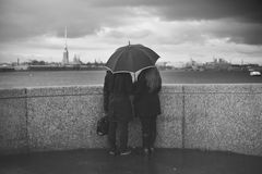 Man and woman under an umbrella Royalty Free Stock Photos