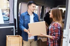 Man and Woman Unloading Moving Van stock photography