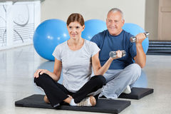 Man and woman using dumbbells Stock Photography