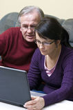 Man and woman using laptop Stock Images