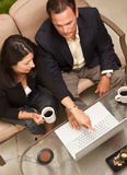 Man and Woman Using Laptop with Coffee Royalty Free Stock Image