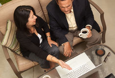 Man and Woman Using Laptop with Coffee Stock Image
