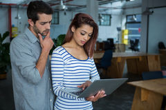 Man and woman using laptop Stock Image