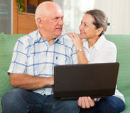 Man and woman using laptop at home Stock Photos