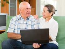 Man and woman using laptop at home Royalty Free Stock Photo
