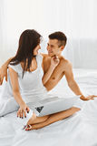 Man and woman using laptop at home Royalty Free Stock Image
