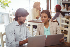 Man and woman using laptop during meeting Royalty Free Stock Photo