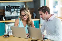 Man and woman using laptop during meeting Royalty Free Stock Photography