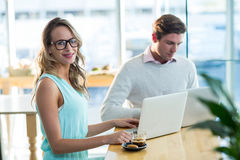 Man and woman using laptop during meeting Royalty Free Stock Images