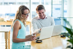 Man and woman using laptop during meeting Stock Photo