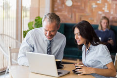 Man and woman using a laptop during meeting Royalty Free Stock Photography