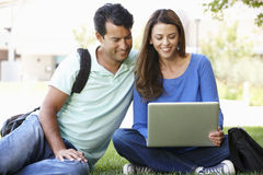 Man and woman using laptop outdoors Royalty Free Stock Photography