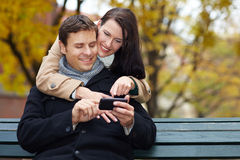 Man and woman using smartphone Royalty Free Stock Photos