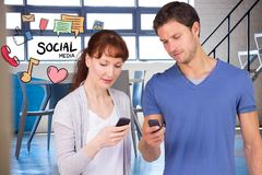 Man and woman using social media on smart phones Royalty Free Stock Photography