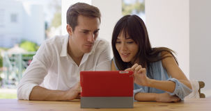 Man and woman using a tablet computer together Royalty Free Stock Images