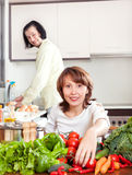 Man and woman with vegetables in kitchen Royalty Free Stock Images
