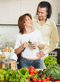 A man and a woman with vegetables in the kitchen Stock Photography
