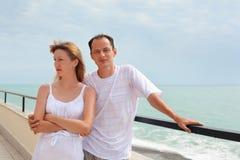 Man and woman on veranda near seacoast Royalty Free Stock Photo