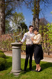 Man and woman in Victorian clothing, pillar and su Royalty Free Stock Images