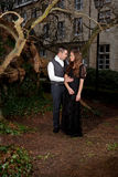 Man and woman in Victorian clothing embracing in the park Royalty Free Stock Photo