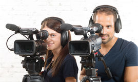 A man and a woman with video cameras Royalty Free Stock Image