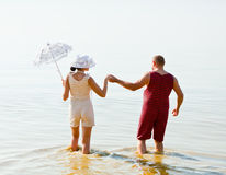 Man and a woman in vintage striped bathing suits Stock Photography