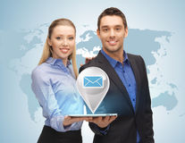 Man and woman with virtual email sign Stock Photo