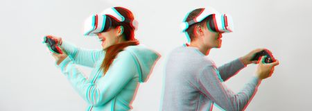 Man and woman with virtual reality headset are playing game. Image with glitch effect. royalty free stock photo